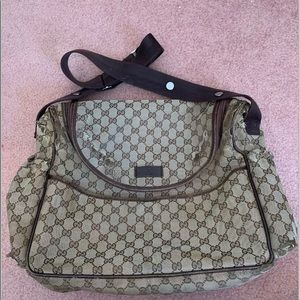 Well loved Gucci diaper bag